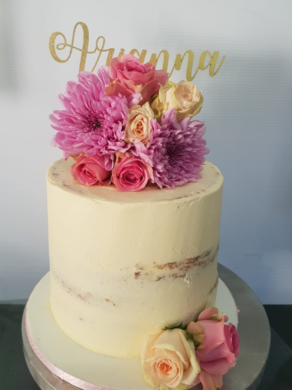 wedding cakes can be simple or complex. This simple cake has a flower design to it that says a breath of fresh air.
