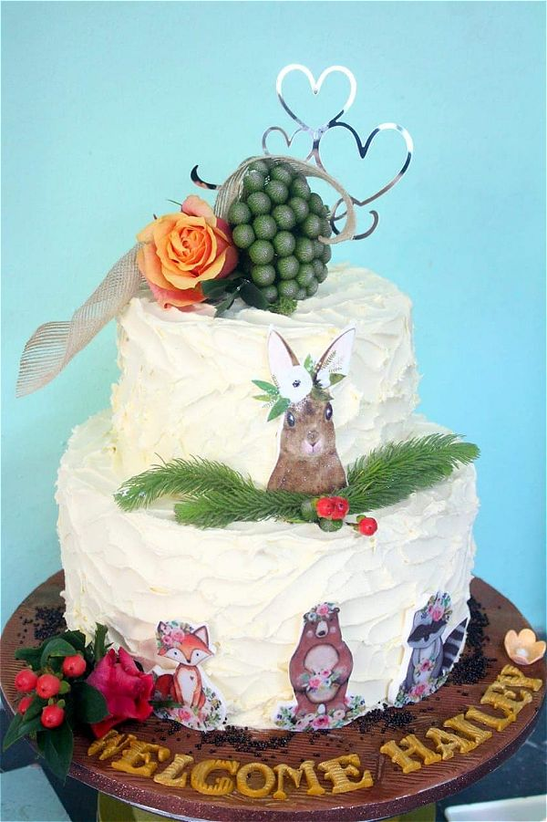 This is a cute baby shower cake with mystical creatures like rabbits, foxes, bears and raccoons. This image was taken in Johannesburg, South Africa