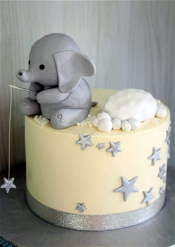 cute baby elephant with simple cream and sliver colours. This image was taken in Johannesburg, South Africa