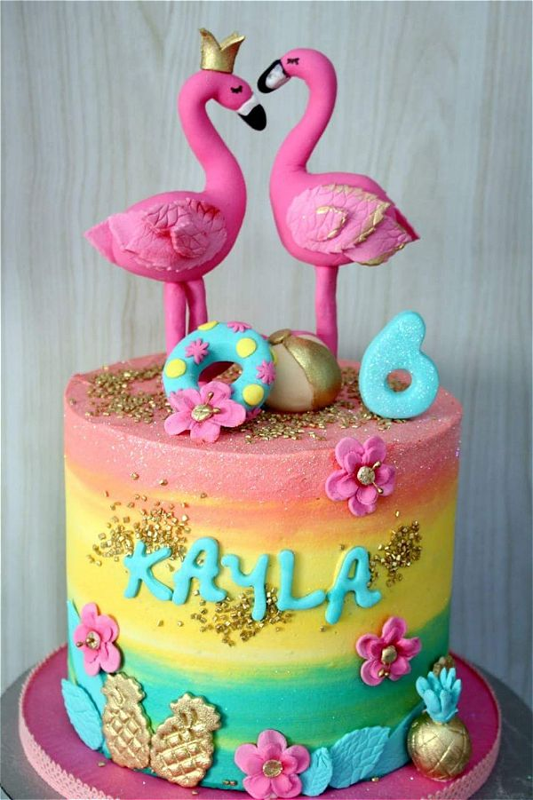 two flamingos on top of a rainbow cake for a girls birthday cake. This image was taken in Johannesburg, South Africa