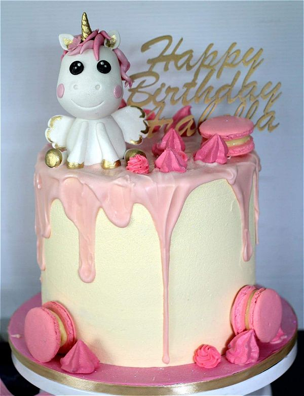 flying unicorn drip cakes for girls are a real hit right now. This image was taken in Johannesburg, South Africa