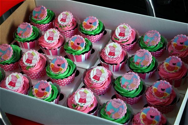 Pepper pig and the whole family theme cupcakes. This just looks like a yummy box full of pink cupcakes. This image was taken in Johannesburg, South Africa