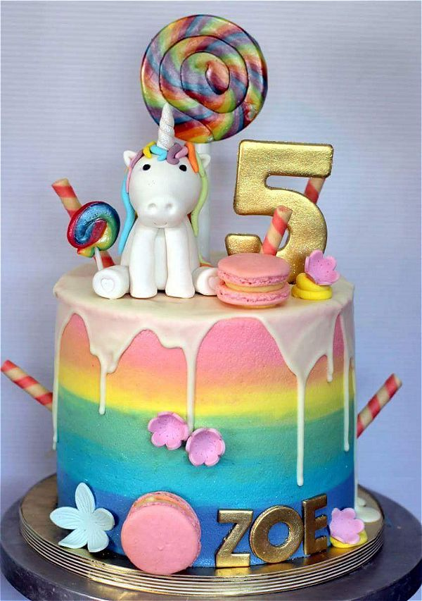 5th birthday party with a cute unicorn drip cake theme. Lovely with the dripping icing. This image was taken in Johannesburg, South Africa